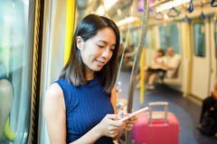 Woman use of smart phone. In train compartment Stock Photos
