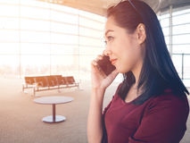 Woman use smartphone in airport. Stock Photography