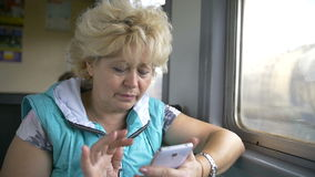 Woman use smartphone interior of train, slow motion stock video