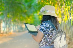 A woman use tablet for business royalty free stock image