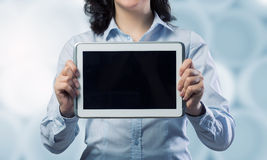 Woman use tablet device . Mixed media Royalty Free Stock Images