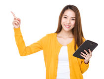 Woman use of tablet and finger point up Stock Images