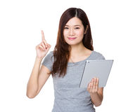 Woman use of tablet and finger point up Royalty Free Stock Photo