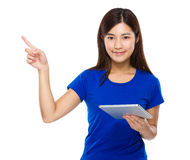 Woman use of tablet and finger point up Stock Photo