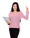 Woman use of tablet and finger point up Royalty Free Stock Photography