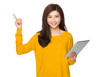 Woman use of tablet and finger up Royalty Free Stock Photography
