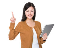 Woman use of tablet and funger point up Royalty Free Stock Photo