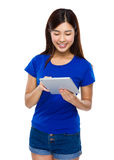 Woman use of tablet Royalty Free Stock Photos