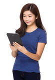 Woman use of tablet Royalty Free Stock Photo