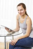 Woman use tablet in the kitchen Stock Photos