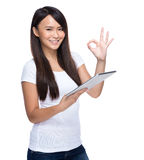 Woman use tablet with ok sign Stock Photos