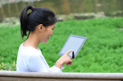 Woman use tablet outdoor Royalty Free Stock Photo