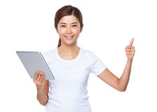 Woman use tablet and thumb up Stock Photos