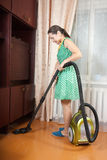 Woman use vacuum cleaner Stock Images