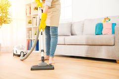 Woman use vacuum cleaner to cleaning Stock Photo