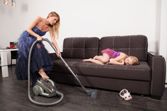 Woman use vacuum cleaner stock photo