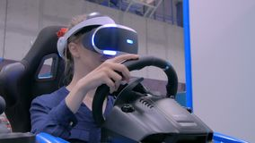 Woman use virtual reality helmets, play the racing simulator. Video game ad technology concept stock footage