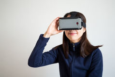 Woman use of vr device Stock Images
