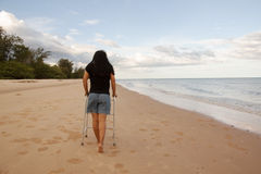 Woman use walker on sand beach Royalty Free Stock Images