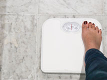 Woman use wieght scale Stock Images