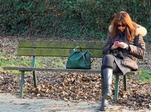 Woman  use your mobile phone Royalty Free Stock Photography