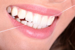 Woman used a dental floss Stock Image