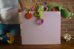 Woman with used toys in secondhand shop. Young girl with used toys in secondhand shop Stock Photo