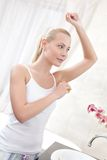 Woman uses antiperspirant Stock Image