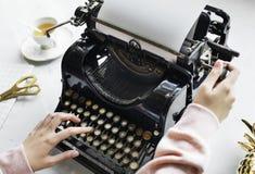 Woman Uses Black Typewriter Stock Photos