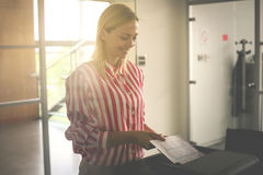 Woman uses copier. Businesswoman using photocopier in. Business woman uses copier. Businesswoman using photocopier in office Stock Image
