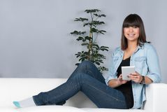 Woman uses an ebook reader Stock Image