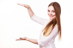 Woman uses hands to indicate area of frame, copy space for product Stock Photo