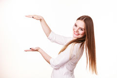 Woman uses hands to indicate area of frame, copy space for product. Woman showing presenting, long haired fashion girl uses hands to indicate area of frame, copy Stock Image