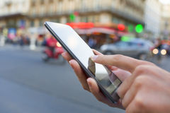 Woman uses her smart phone on the street in Paris Stock Photos