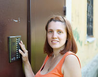 Woman uses intercom Royalty Free Stock Photography