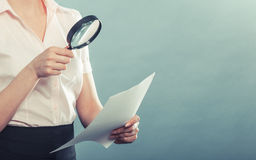 Woman uses magnifying glass to check contract. Business woman using magnifying glass to check contract instagram filter photo Royalty Free Stock Photography