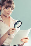 Woman uses magnifying glass to check contract Stock Image