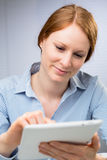 Woman Uses a Tablet Computer Stock Images