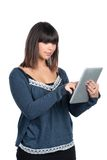 Woman uses a tablet Royalty Free Stock Photo
