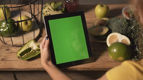Woman Uses Tablet at Kitchen Table stock footage