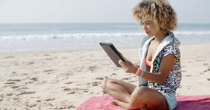 Woman Uses Touchpad Tablet On The Beach Royalty Free Stock Photo