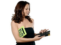 Woman using abacus and holding calculator Royalty Free Stock Photo