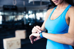 Woman using activity tracker. At gym stock photos