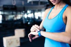 Woman using activity tracker Stock Photos