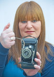 Woman using antique camera. Stock Photo