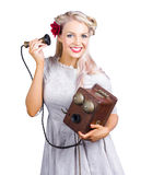 Woman using antique telephone Stock Image