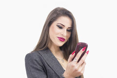 Woman using an app on her smartphone Stock Photo