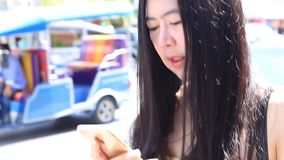Woman using app on smartphone. In cafe stock video footage