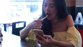 Woman using app on smartphone. In cafe stock footage