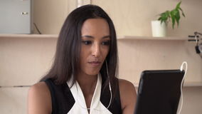Woman using app on touch screen tablet for video call. Asian businesswoman has online meeting with partner use internet. Attractive mixed race female phones stock footage